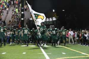 Senior Jacob Reese carries the flag and leads MV onto the field two minutes before the start of the second half.