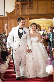 Newlyweds walking down the isle