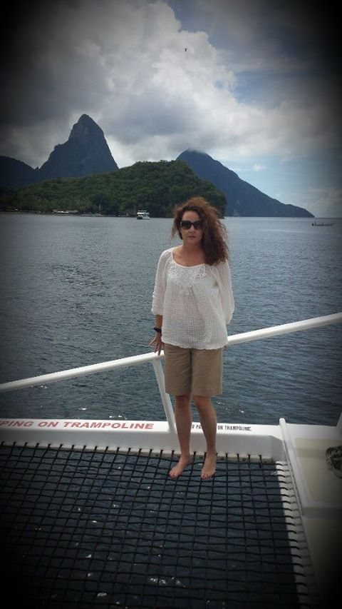 Nancy on her way to the hotel in St.Lucia, with the Pitons in the background