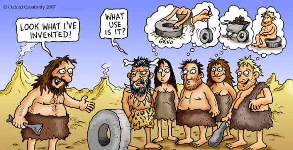 cartoon of cave people with one pointing at a wheel and saying 'look what I've invented!', another saying 'what use is it?' and four others all with thought bubbles of different potential uses