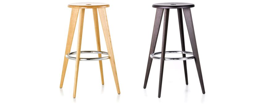 Vitra   Tabouret Haut The classic Tabouret Haut bar stool by Jean Prouv     is available in robust  solid oak  with a natural or dark stained finish  The chrome plated steel  ring