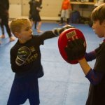 Will hitting the Pads with Luca in his martial arts class