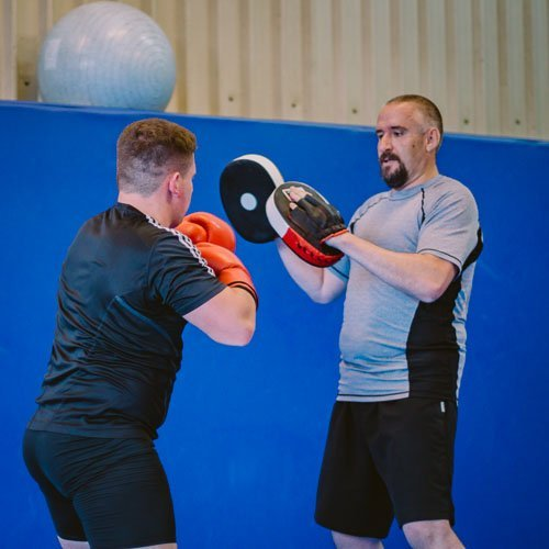 Kyle and Simon doing padwork in a personal training session