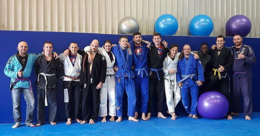 a group photo after iron manning Matt Olson for his Brazilian Jiu Jitsu Brown belt in Tameside