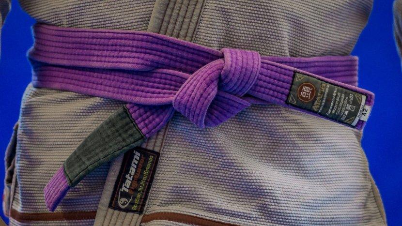 Matt wearing his brazilian jiu jitsu purple belt