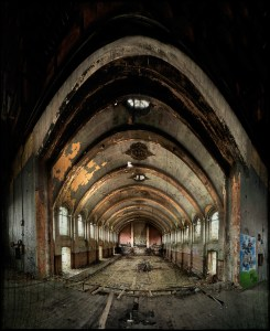 The stage in the hall, with street art, derelict Hellingly Asylum, West Sussex