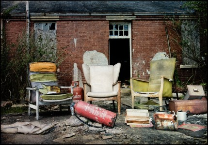 Three battered armchairs outside, derelict Hellingly Asylum, West Sussex