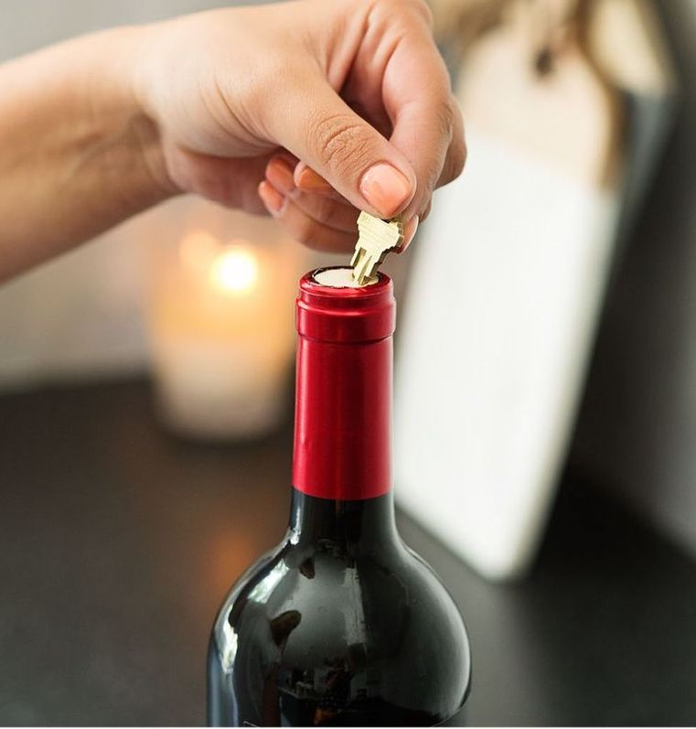 No corkscrew? Use a key to open a bottle of wine instead.