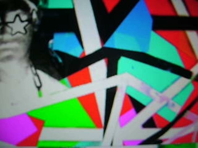 Video mixing still of Scream Club with diamond cutouts by VJ Carrie Gates