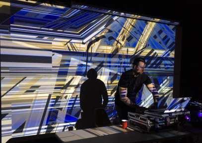 VJ Carrie Gates and DJ Jeff Prankev (aka Dislexic) DJing at PAVED Arts' Submerged Event in Saskatoon, 2019