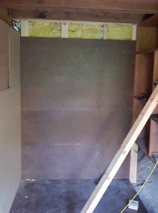 Photo of back wall in progress.