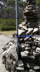 10m squid pole attached to the rock cairn