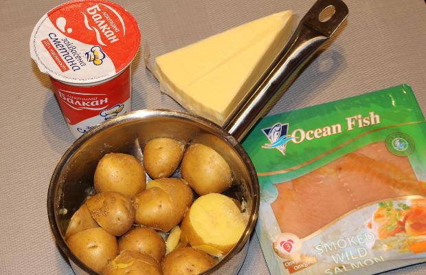 Риба със сметана и картофи на фурна