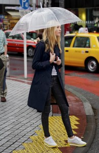 Ella Richards wearing a navy Burberry Heritage Trench Coat in Tokyo