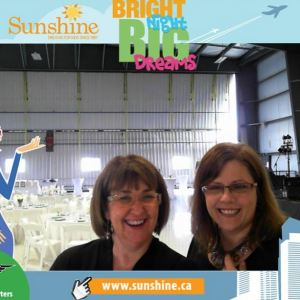 Event organizer Sheila Harrison and I pose in front of the decorated hangar for the in-house photo machine