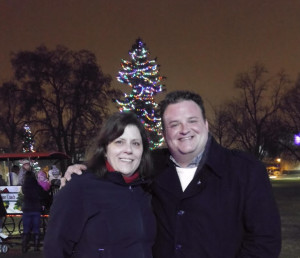 My buddy Eric and I posing in front of a Christmas tree, nighttime, Victoria Park, London