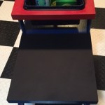 Play table in red and blue with black chalkboard surface