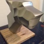 silver-coloured metal dog head sculpture