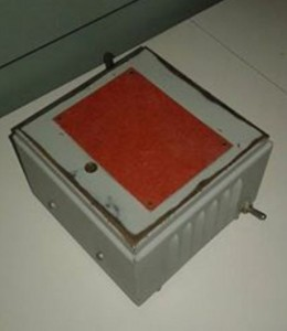 metal cube with a copper-looking layer on top and a simple switch on the side