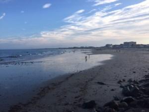 mostly deserted, long, sandy beach