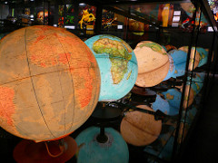 a collection of lit globes of the world