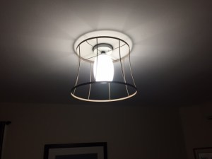 Tan fixture with white globe, lit up