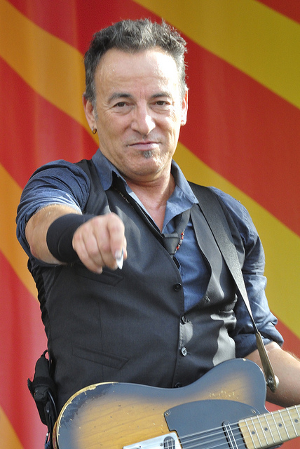 Bruce Springsteen on stage pointing to the camera
