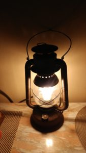 railroad lantern with an Edison bulb inside, lit up