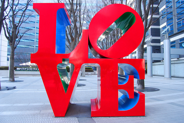 Huge red letters spelling LOVE on a city street