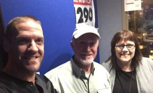 Brian Salt flanked by me and Ken in front of the 1290 CJBK banner