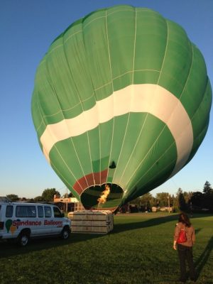 as the balloon inflates, I'm watching from a distance