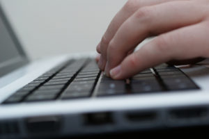 close-up of fingers on a keyboard