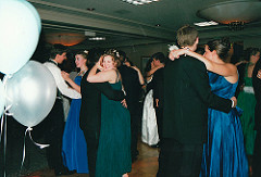 bunch of dressed up kids dancing at their prom