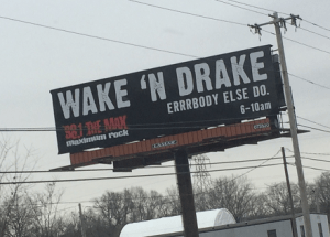 "Billboard for Wake N Drake, a morning show on a rock station that airs 6-10 am. The slogan is ""Errrbody else do."" That's not a typo."