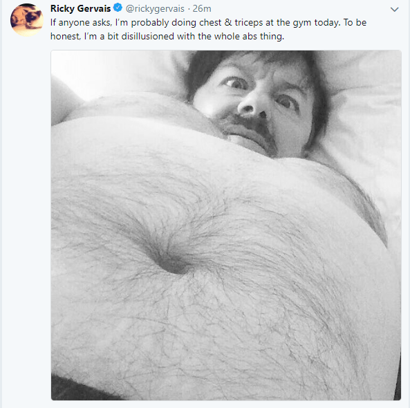 selfie taken with his belly in the foreground. The tweet suggests he's given up on working on his abs in the gym