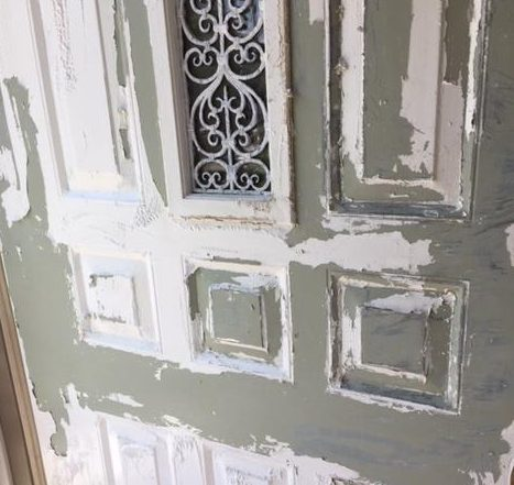 green metal showing through under white paint