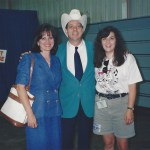 Me with Junior Brown and his wife. Jr is a small man who wears a very big hat