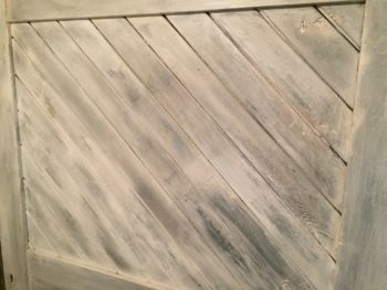 closeup of the distressed, white boards in the headboard