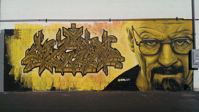 tagged concrete block wall with a perfect rendering of Walter White aka actor Brian Cranston