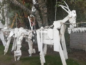 White reindeer made of metal scraps