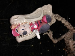 MIckey Mouse caught in the jaws of a dinosaur