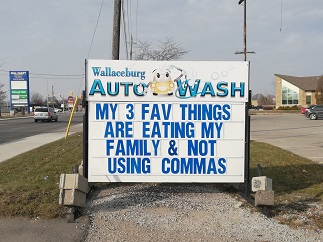 Wallaceburg Auto Wash sign reads: My 3 fav things are eating my family and not using commas.
