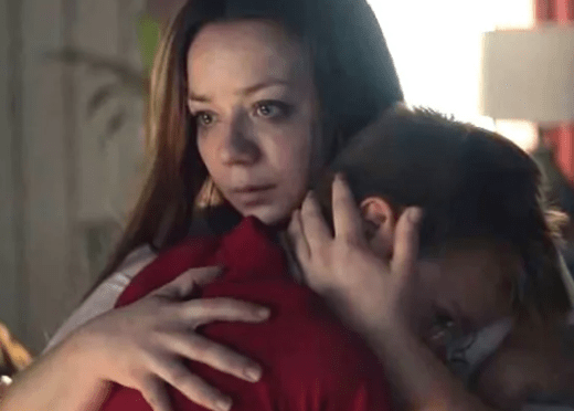 Mom hugs her boy after he was teased by other boys for crying over a movie - a still from the Gillette video