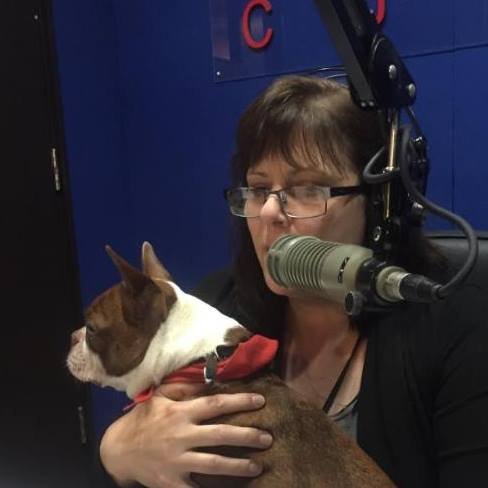 Me on the air with a little terrier in my arms.
