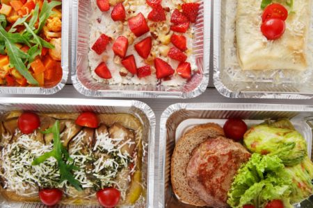 various dinners - chicken burger, salad etc. - in delivery cartons