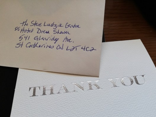 Front of a thank-you card and the envelope addressed to the Steve Ludzik Centre.