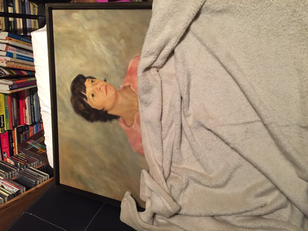 The painting under a blanket and resting on a pillow as if having a nap