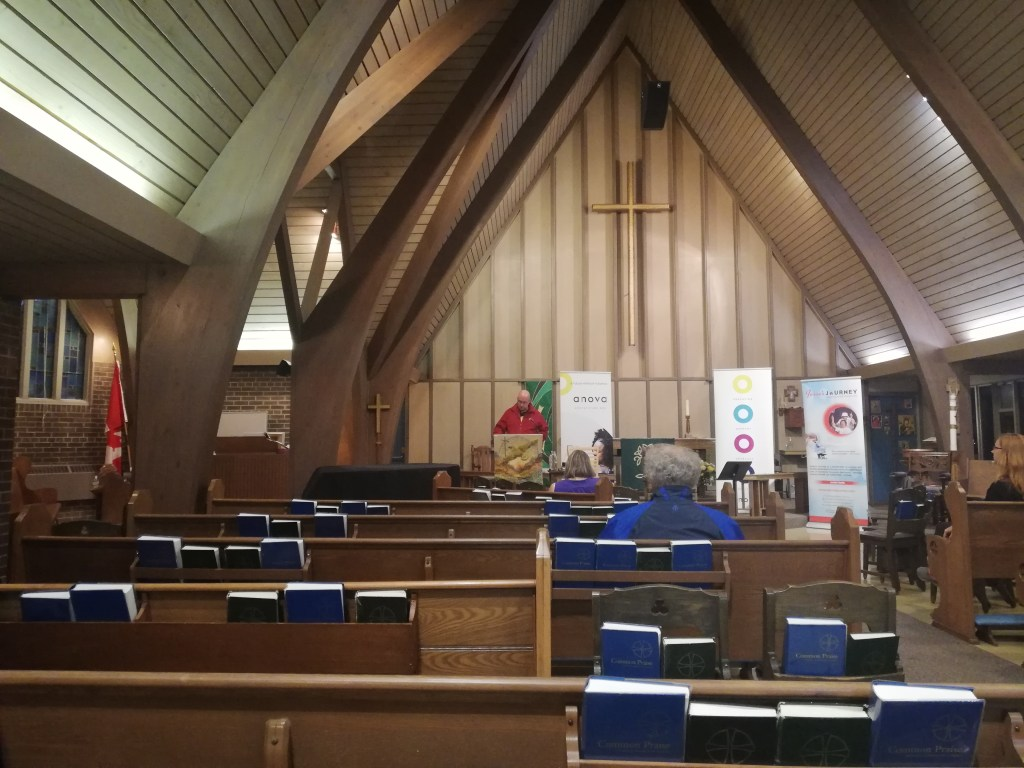 St Aidan's Church is warm and woody. Revy Kevy looks down at his notes. Only two other people are in view in the pews.