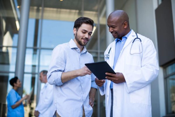 two young happy doctors consulting on a file