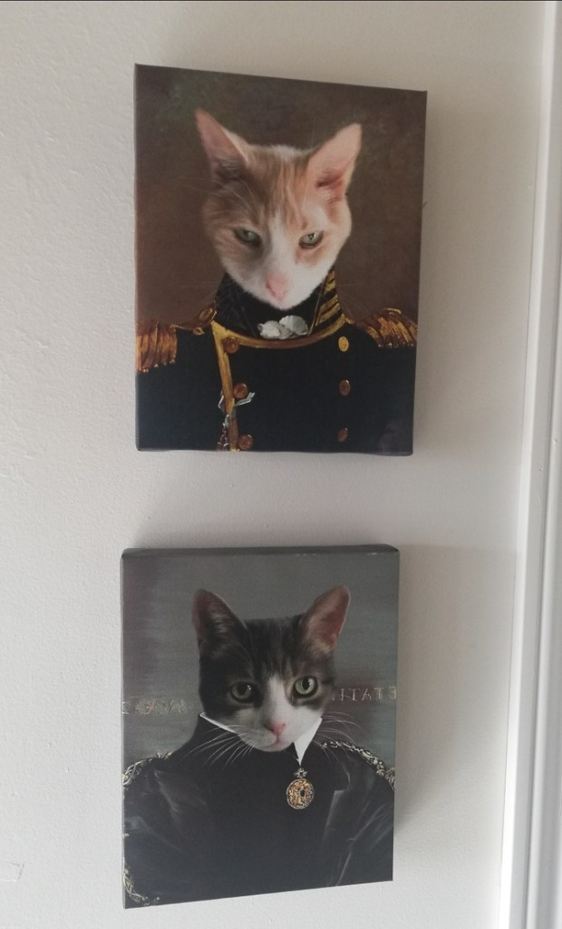 canvas portraits of Spice and Sugar. Spice is dressed as an 18th century admiral and Sugar is an 18th century regal lady with a gold medallion below her throat